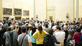 Visitors take photos of Mona Lisa (Leonardo DaVinci), Louvre Museum, stock footage