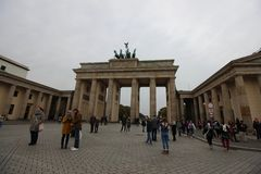 Visitors taking photos of the historic Brandenburg Gate royalty free stock photo
