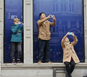 Visitors taking photos of New Year Show London 2016 Royalty Free Stock Images