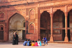 Visitors taking pictures in the courtayrd of Jahangiri Mahal in Stock Images
