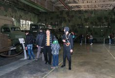 Visitors with a tankman. Visitor in the exhibition pavilion of the Patriotic Association of Lenrezerv stock image