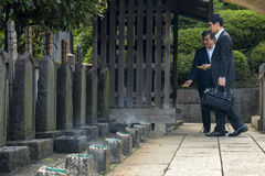 Visitors at temple graveyard Stock Photo