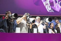 Visitors test huge tele lenses Stock Photo