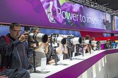 Visitors test huge tele lenses Royalty Free Stock Photo