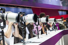 Visitors test huge tele lenses Stock Images
