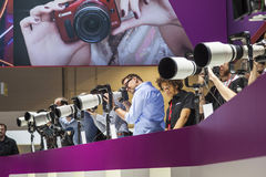 Visitors test huge tele lenses Royalty Free Stock Photo