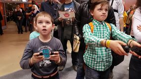 Visitors testing Nintendo gaming console. Moscow, Russia - April 23, 2017: Visitors testing Nintendo gaming console at Hinode Power Japan festival stock video
