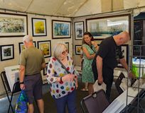 Visitors to a Booth at the 61th Annual Sidewalk Art Show stock photography
