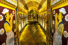Visitors to the Buddhist Temple of the Sacred Tooth Relic in Kandy, Sri Lanka, pass through Ambarawa. Stock Photo