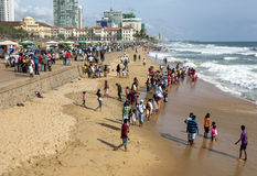Visitors to Galle Face Green enjoy a sunny afternoon along the Indian Ocean in Sri Lanka. Royalty Free Stock Photos