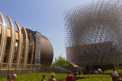 Visitors to the Great Britain Pavilion resembling a bee hive on Milan EXPO 2015 with Hungarian pavilion on the left Stock Images
