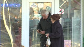 Visitors to the home café on the main street in the town of Pomorie, Bulgaria stock video