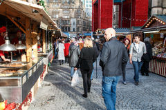 Visitors to the Manchester Christmas market. Manchester,England - November 16th 2015:Manchester Christmas market stalls and visitors Stock Image