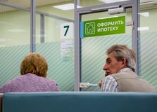Visitors to the mortgage center are waiting for a decision on issuing a loan Stock Photography