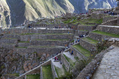 Visitors to Ollantaytambo climb over the terraces at the ancient site in the Sacred Valley of the Incas in Peru. Stock Photo