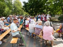 Visitors to the Park listen to the concert of the national song ensemble in Latvia stock photography
