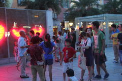 Visitors to play at night in the SHEKOU square in SHENZHEN Stock Photo