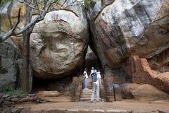 Visitors to Sigiriya Rock in Sri Lanka walk through Boulder Arch Number One. Royalty Free Stock Photography