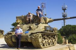 Visitors on top of a discarded Sherman Tank on HarAdar Radar Hill monument stock photo