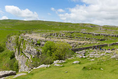 Visitors at the top of Malham Cove Yorkhire Dales UK. YORKSHIRE DALES, ENGLAND, UK-JUNE 7TH 2017: Beautiful sunshine and fine weather was enjoyed by visitors to Stock Photos