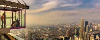 Visitors on top of the Menara KL Tower with panoramic view of Kuala Lumpur Stock Photo