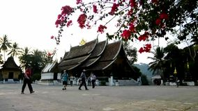 Visitors tour the Wat Xieng Thong Stock Photography
