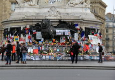 Visitors traveling in the city, standing in front of Charlie Hebdo memorial,Place de la Republique,Paris,2016. Moving tribute of lives lost in the Charlie Hebdo Stock Photography