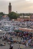 Visitors and vendors crowd the colourful Djemaa el-Fna, the main square in the Marrakesh medina in Morocco. Stock Photos