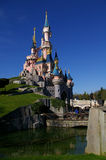 Visitors view Sleeping Beauty castle at Disneyland Paris France. Sleeping Beauty's castle sits on a small hill at  Disneyland Paris in France. A man and woman Stock Image