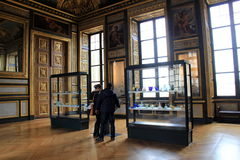 Visitors viewing many priceless masterpieces displayed in The Louvre,Paris,France,2016. Visitors viewing many gorgeous examples of priceless masterpieces inside Royalty Free Stock Images