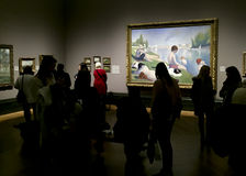 Visitors viewing paintings in the National Gallery, london Stock Photo