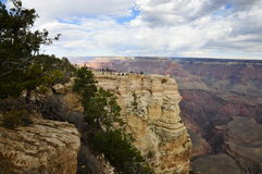 Visitors at viewpoint on Grand Canyon South Rim Royalty Free Stock Photography