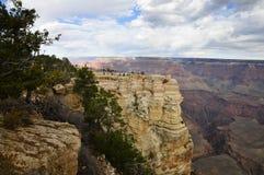 Visitors at viewpoint on Grand Canyon South Rim Royalty Free Stock Photography