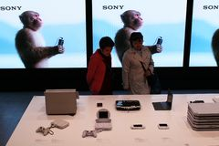 Visitors views exhibits in an exhibition of Sony products. Royalty Free Stock Image