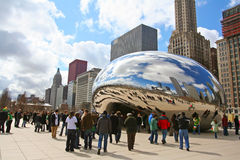 Visitors visit Bean or Cloud Gate at Millennium Park Royalty Free Stock Photo