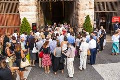 Visitors wait outside the arena di Stock Photo