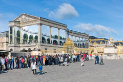 Visitors waiting in a queue to visit the Palace of Versailles, Paris, France Stock Image