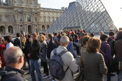 Visitors waitng for the Louvre entrance Stock Images