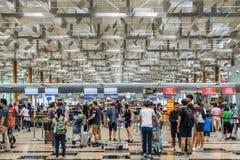 Visitors walk around Departure Hall in Changi Airport Singapore Royalty Free Stock Photo