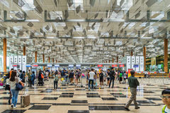Visitors walk around Departure Hall in Changi Airport Singapore Royalty Free Stock Image