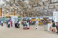 Visitors walk around Departure Hall in Changi Airport Singapore Stock Photo
