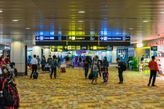 Visitors walk around Departure Hall in Changi Airport Singapore stock photography