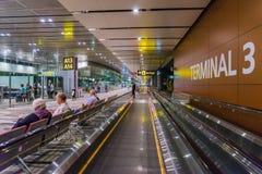 Visitors walk around Departure Hall in Changi Airport Singapore Stock Photos