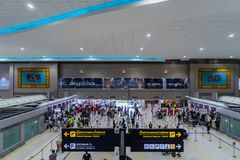 Visitors walk around Departure Hall in Don Muang International A Royalty Free Stock Photography