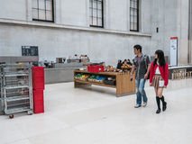 Visitors walk past Great Court cafe in British Museum Stock Image
