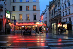 Visitors walking in the dusk and rain through the streets of Paris,France,2016 Royalty Free Stock Photos