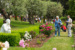 Visitors walking among the roses in  Cervantes Park Stock Photos