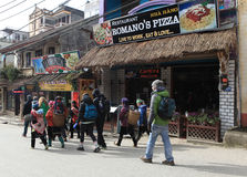 Visitors walking on a street with many restaurants in Sapa Stock Photo