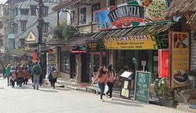 Visitors walking on a street with many restaurants in Sapa Royalty Free Stock Photos