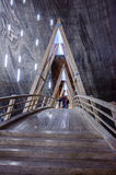 Visitors walking on a wooden bridge in salt mine T Stock Photography